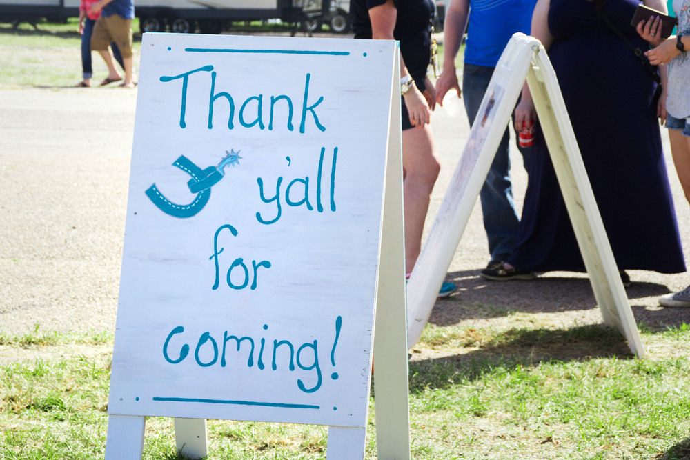 A friendly sign showcases southern charm, thanking guests for attending the BBQ Austin event.