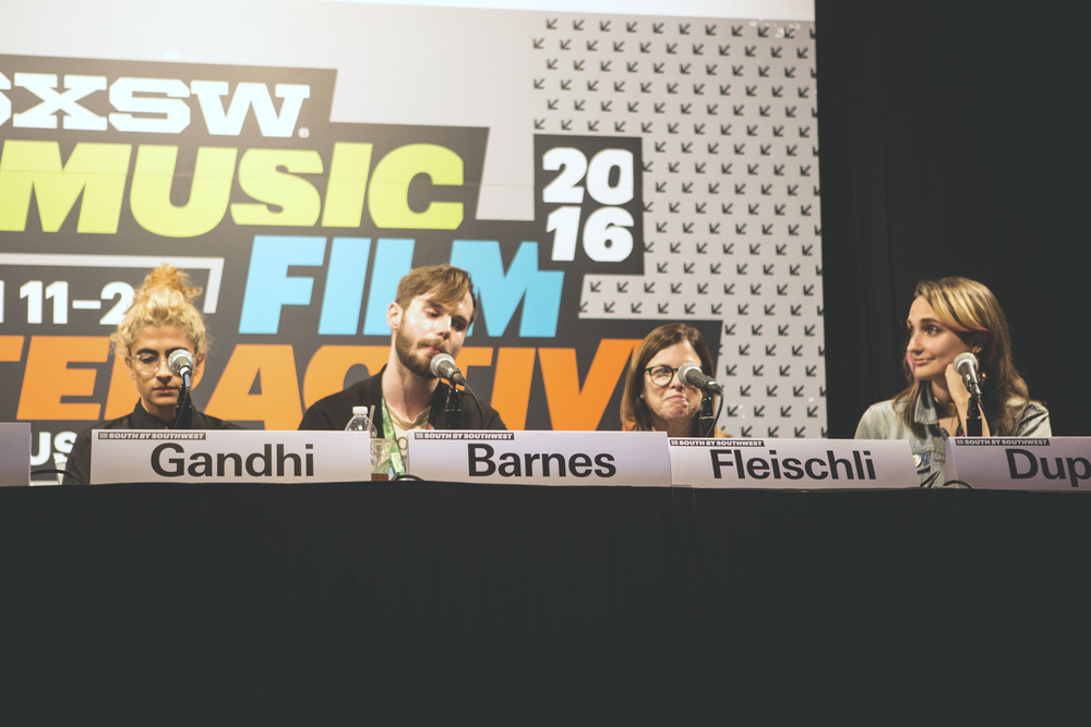 "Kiran Ghandi, Tom Barnes, Michele Fleischli and Sadie Dupuis sit together for the SXSW panel ""Representations of Women in Music Media."""