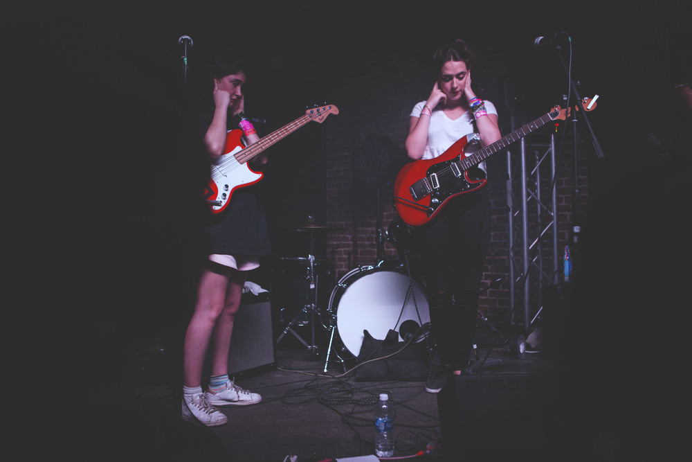 Hinds, a garage rock group from Spain, covers their ears during their soundcheck at the Main II on March 18. The soundcheck ran 30 minutes overtime and the group performed their set despite ongoing sound difficulties.