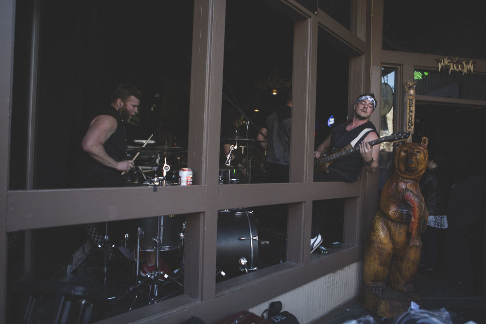 A band leans out of a venue window on Sixth Street on March 19.