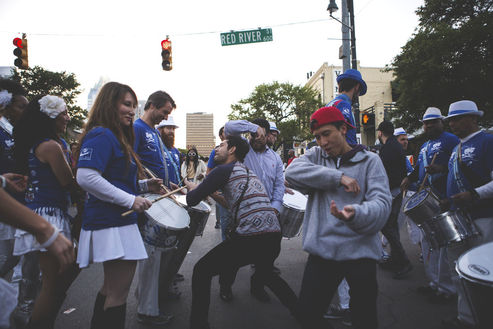 SXSW attendees dance with street performers on the corner of Sixth and Red River on March 19.