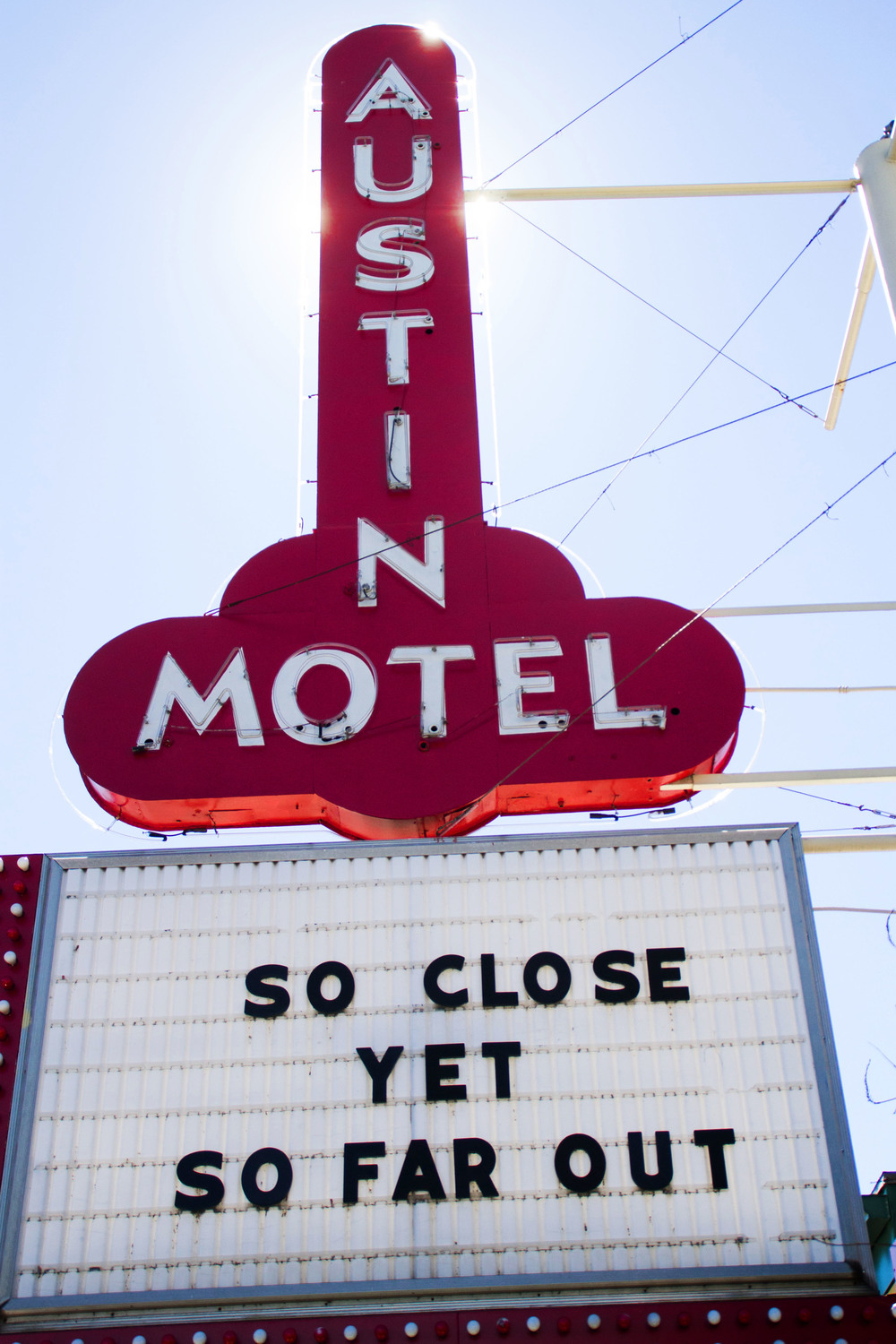 """So close yet so far out."" The Austin Motel's marquis represents Austin's wacky vibe, as the sun shines down on South Congress."