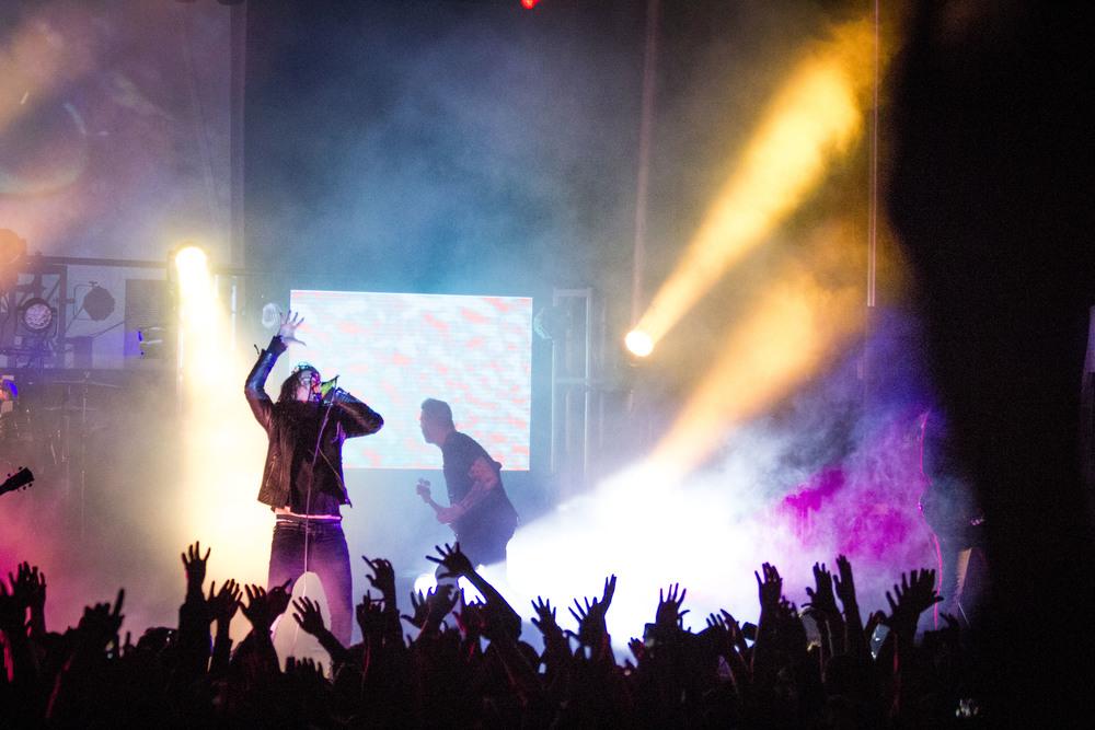 Underoath performs.