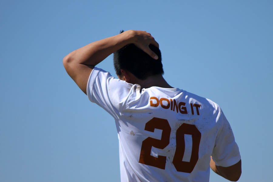 UT ultimate frisbee player Ryan Ng-Thomas takes a breather during a heated match against UH.