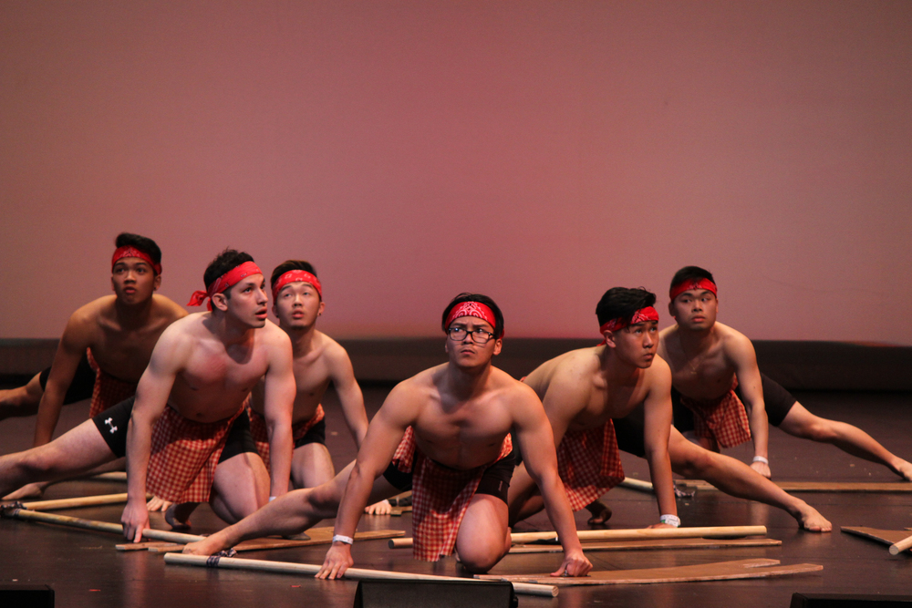 """Members of UT Arlington's cultural dance team acted as warriors in their performance of the traditional dance called """"Idaw."""""""