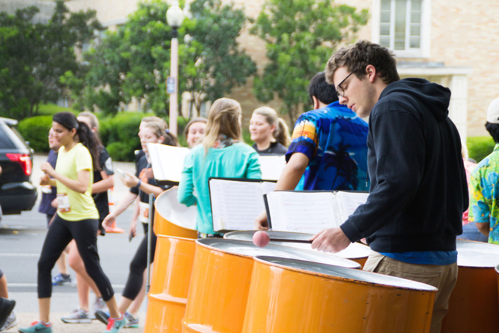 At the intersection of Dean Keeton Street and Whitis Avenue, musicians play peppy tunes to keep the runners in good spirits and at good pace.