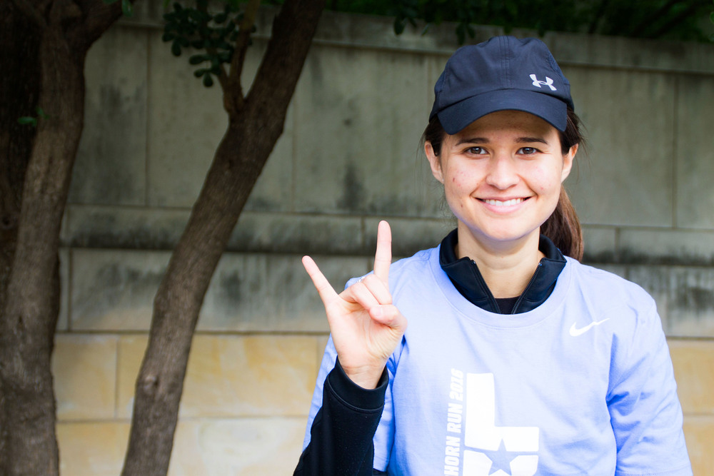 Third year computer science major Jessica Paz volunteers at the Longhorn Run for the first time. Though she's not running in this race, she volunteers just because she likes running in general.