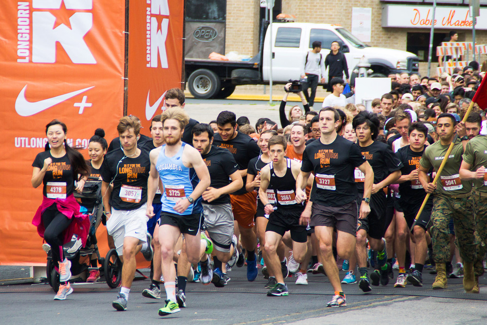 On your mark, get set, go! The front line of runners sprints upon the sound of the cannonfire, kicking off the 5K race.