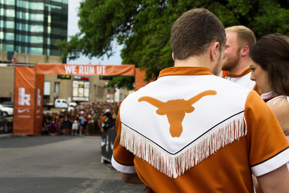 Longhorn cheerleaders support the participants and wait on the sidelines for the race to start.