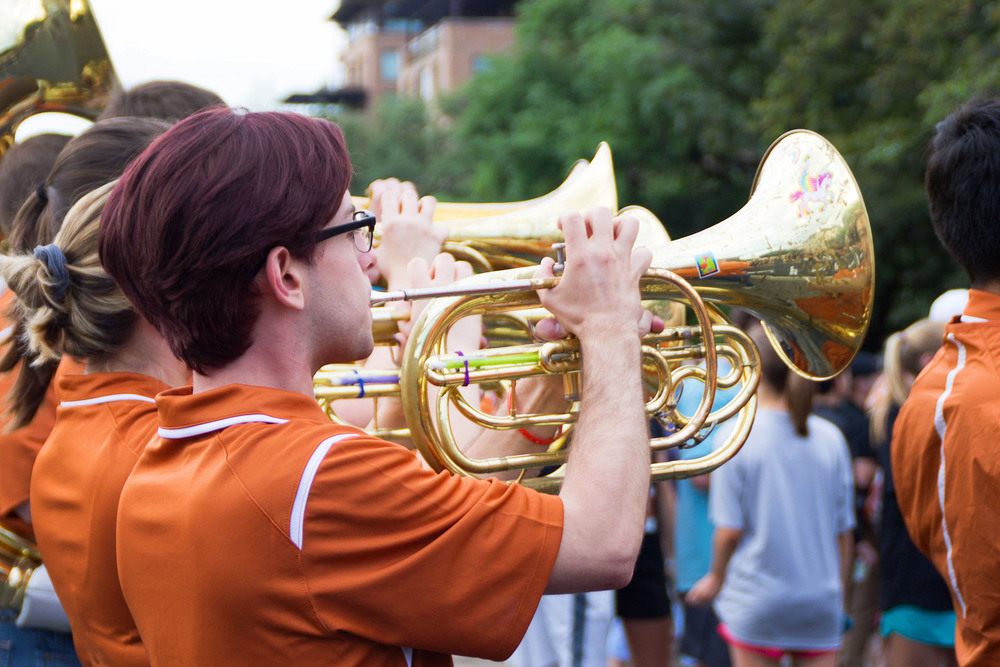 UT's Longhorn Band plays upbeat songs at the start of the race, sending off the runners with a fanfare.