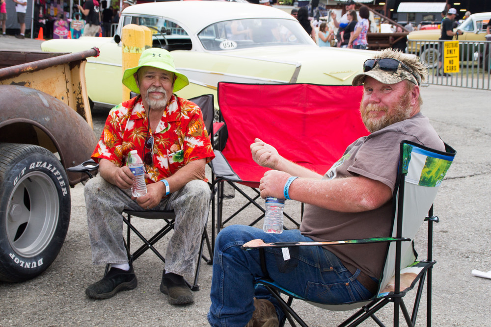 Friends Jacques Tixier and JB Kingston relax next to their showpieces. Although Kingston isn't a mechanic like Tixier, they share a love of cars. They've held a fast friendship ever since they met years ago in the junkyard where Tixier often finds his car parts.