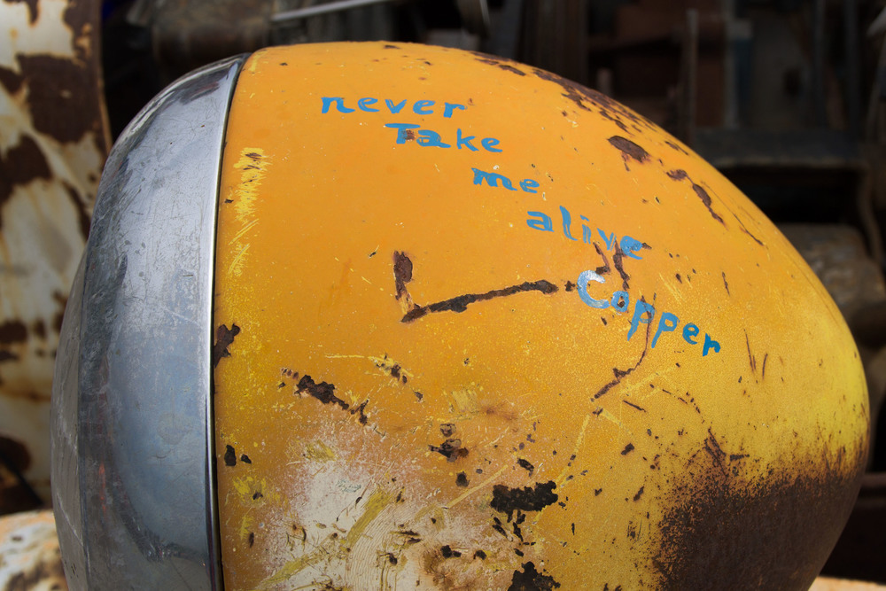 """Jacques Tixier wanted to establish his car as a rebel vehicle. The words """"never take me alive Copper"""" painted on the car's left headlight certainly gets the message across."""