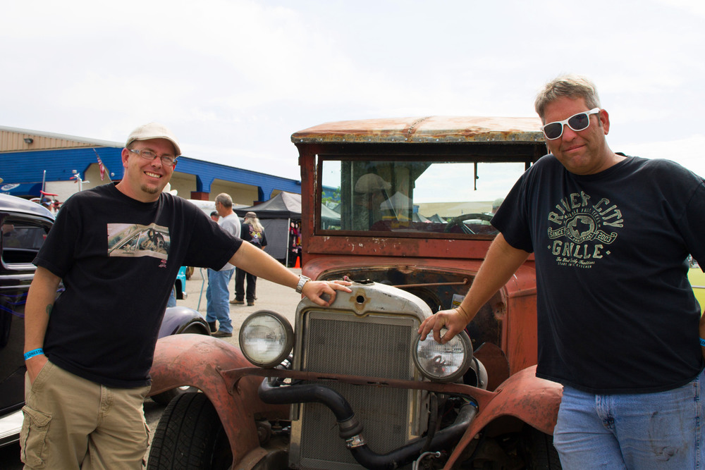 """Billy Kingston and Chris Carnahan smile and stand next to a car they built for Kingston's mom, Kelly. Although the car took six months to build, there wasn't a lot of planning involved, says Kingston. """"It was a drunken moment, and it just went from there,"""" he says."""