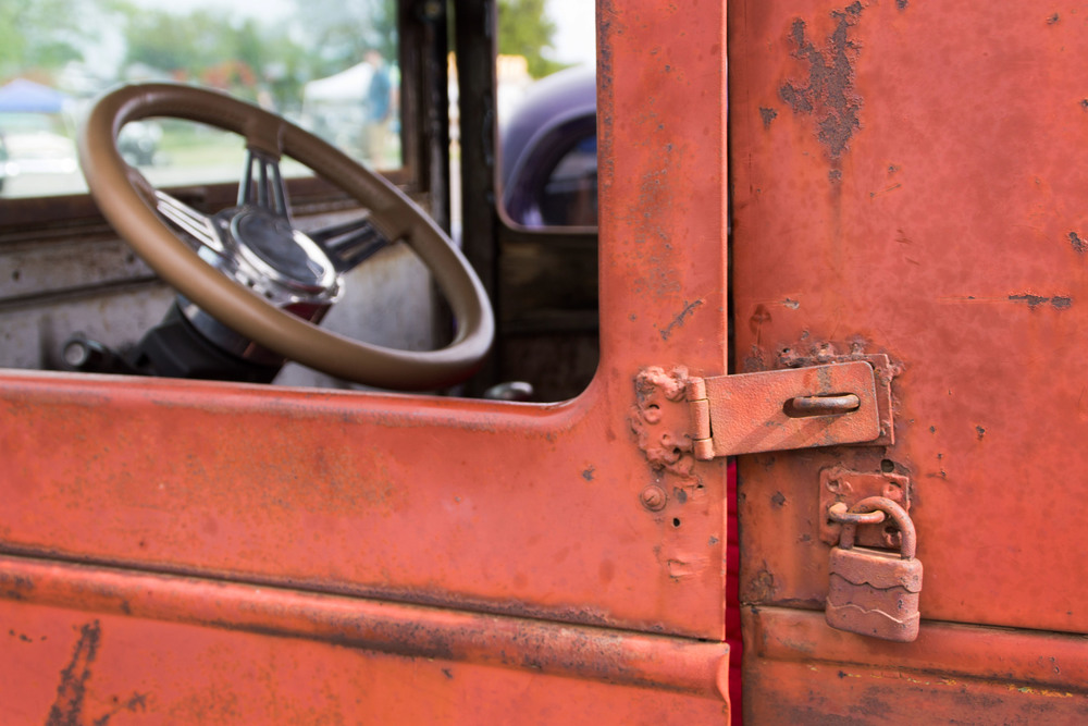 Peeling red paint on rusting metal, this car, built by Kingston and Carnahan features rustic accents.
