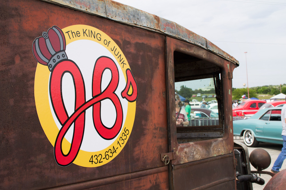 """The King of Junk:"" JB Kingston's car decal plays on his last name, loudly advertising for his junk-hauling business."