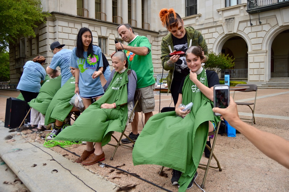 More than 150 people shaved their heads at Brave the Shave.