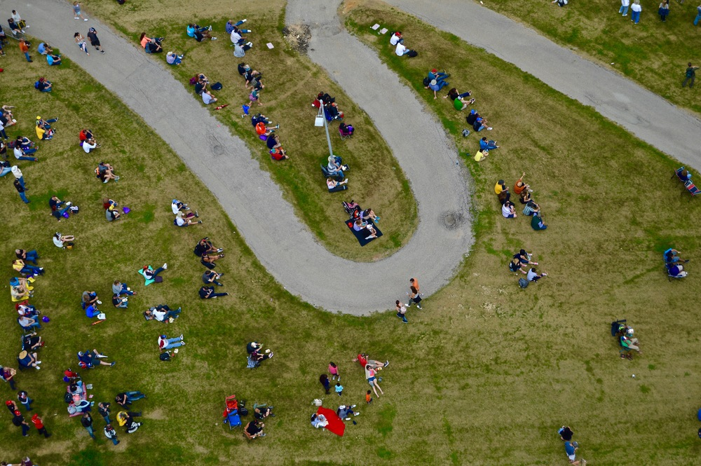 Fans without a seat sit on the lawn at the 2016 Moto GP, the wildest motorcycle racing in the world.    Photo by Alejandra Martinez