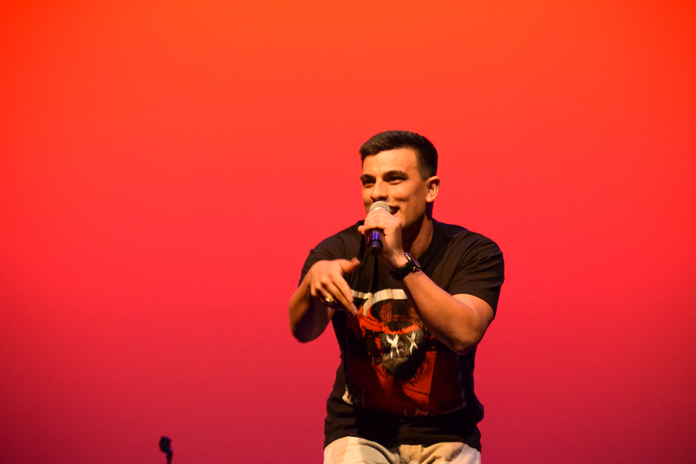 Tone Royal, a.k.a. Ray Villarreal, pumps up the crowd with his 90's hip-hop style rap.