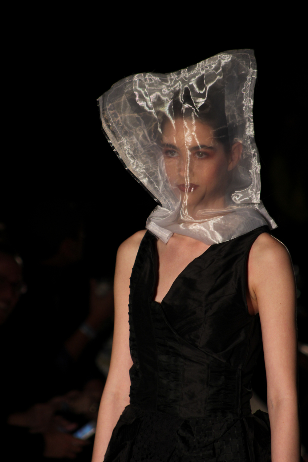 All focus is on Gail Chovan's dress as the model's face is obscured by a transparent bag. Photo by Miranda Chiechi.