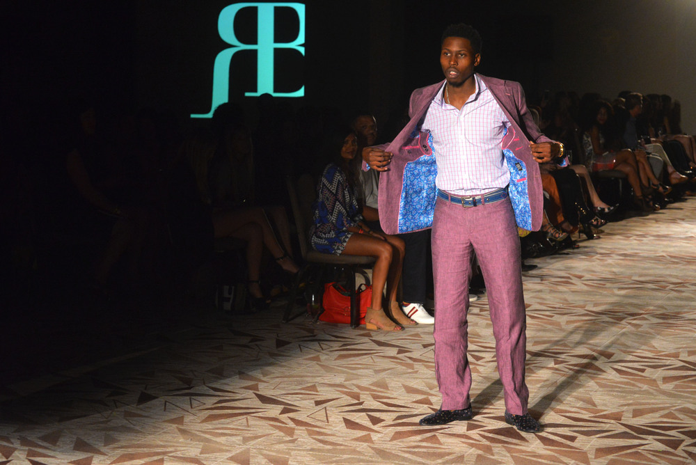 A model shows off the interior lining of his Ross Bennett suit jacket. Photo by Dahlia Dandashi.