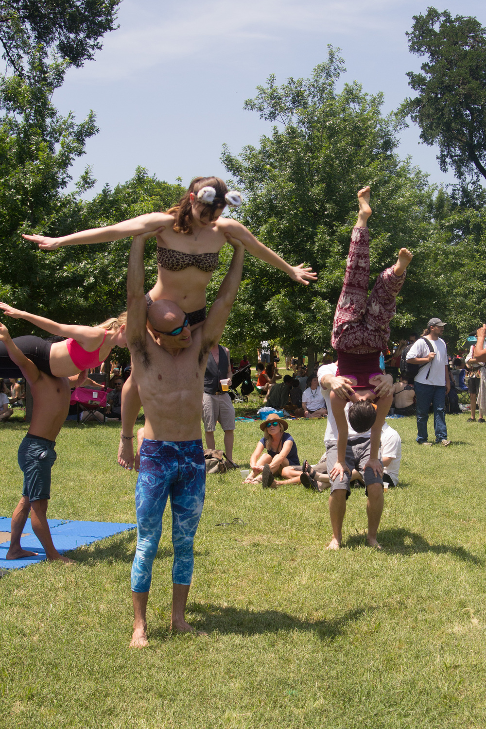 Participants in an acro-yoga demonstration.