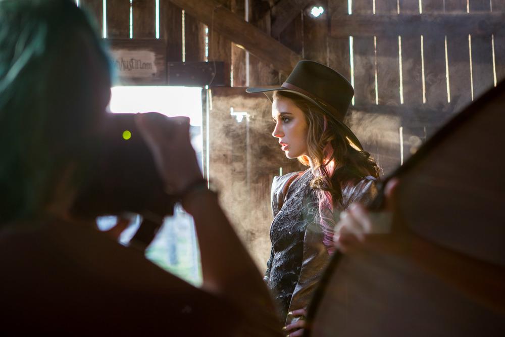 Photographer Nico Nordström captures model Anna Cash as fog bleeds seeps the wooden wall behind her.