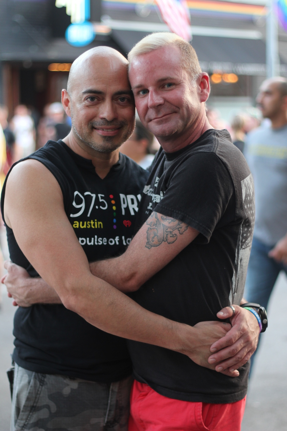 Friends Ross and Gil hug each other following the vigil and offer support to their community.