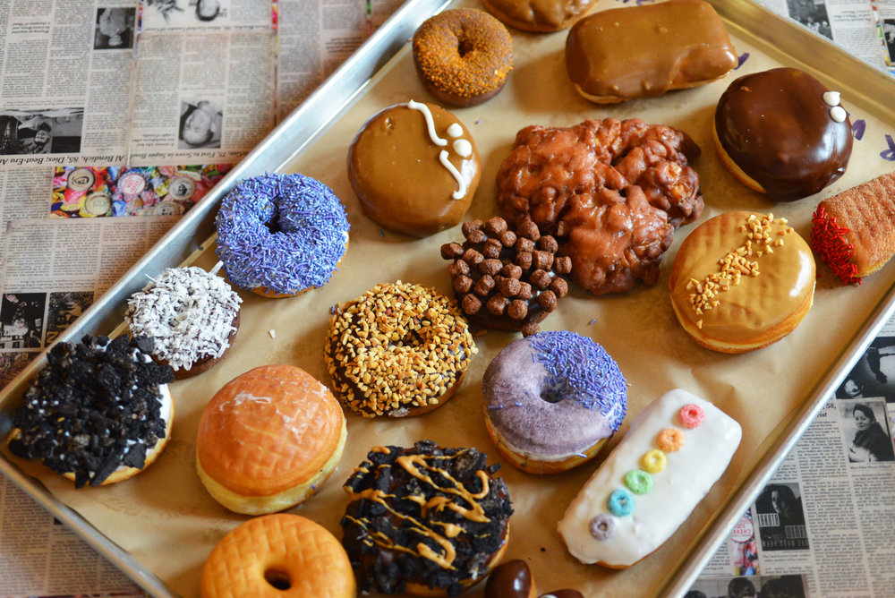 Voodoo Donuts offers a diverse assortment of vegan donuts, including favorites such as the Old Dirty Bastard and the Triple Chocolate Penetration.
