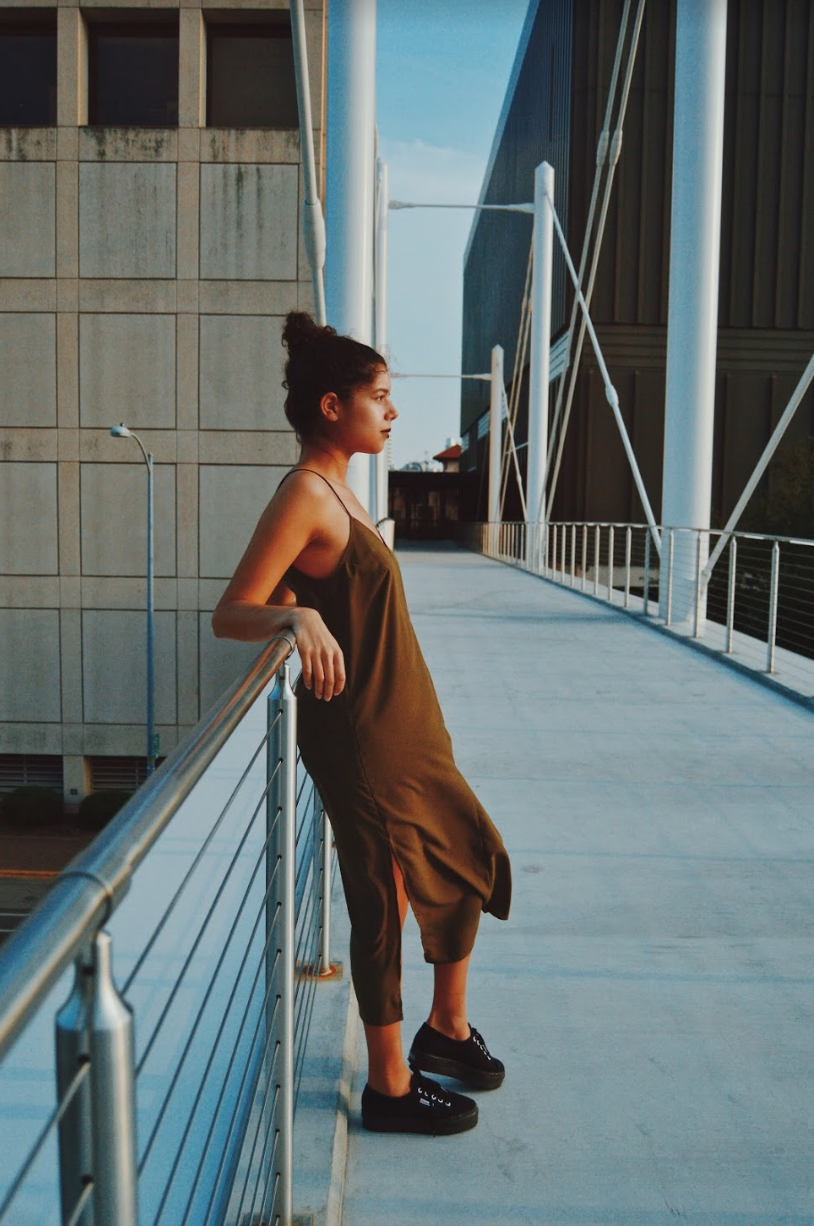 Perez wears an olive green slip dress by The Fifth Label. Shoes pictured are model's own.