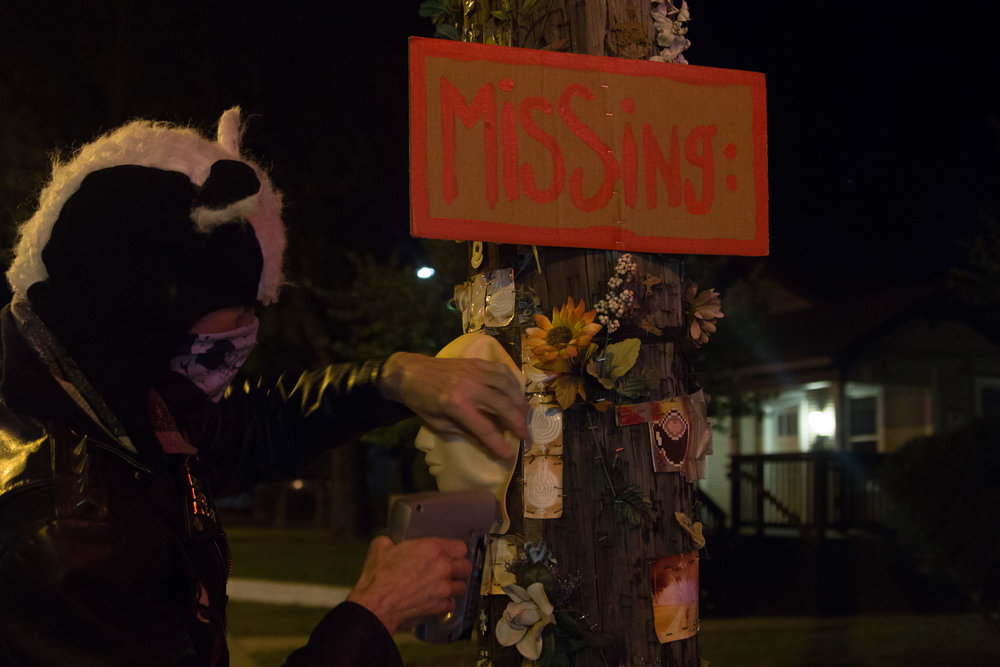 "The ""missing"" sign on this poll was added to RabbitSnake's sculpture by an unknown artist. ""[Art] is a collaborative thing, which I encourage,"" RabbitSnake says. ""Ultimately I'd like to see more people decorate the poles of their neighborhoods."""