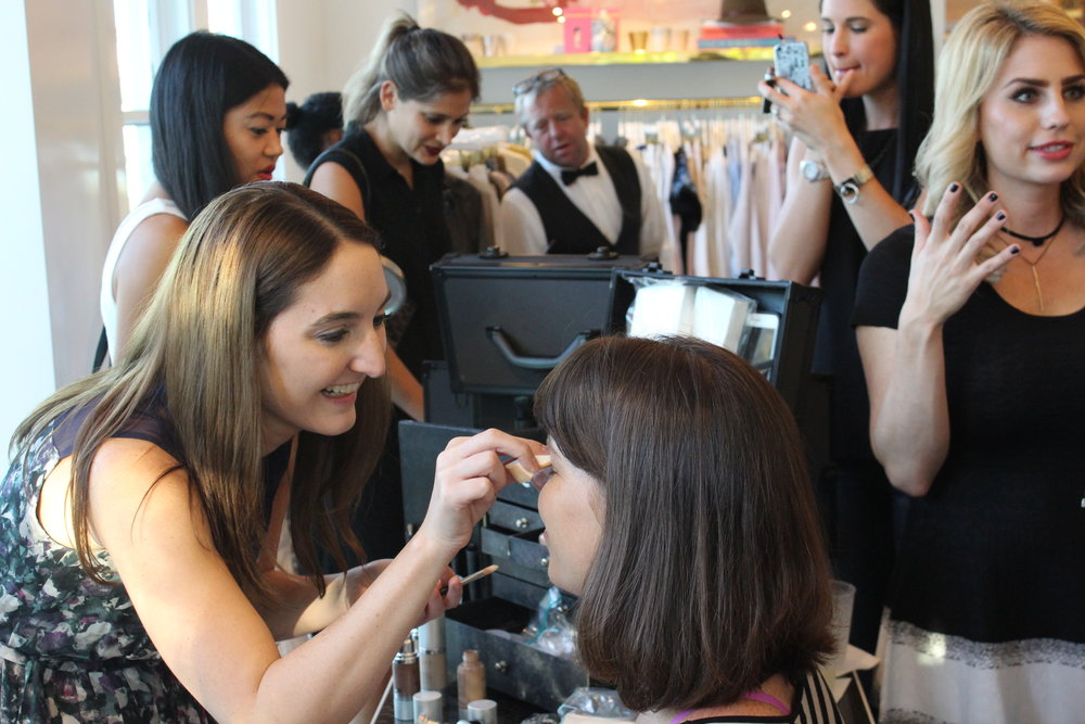 Party attendants try out Gertie Wilson's cosmetic line Elevé.