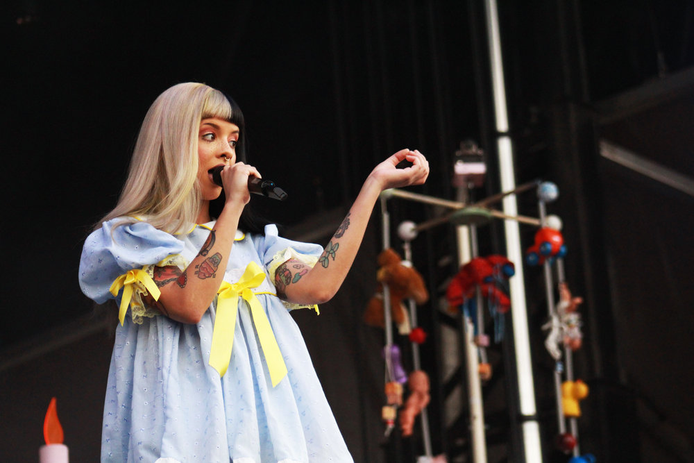 Melanie Martinez, a former competitor on The Voice, sings to the crowd.