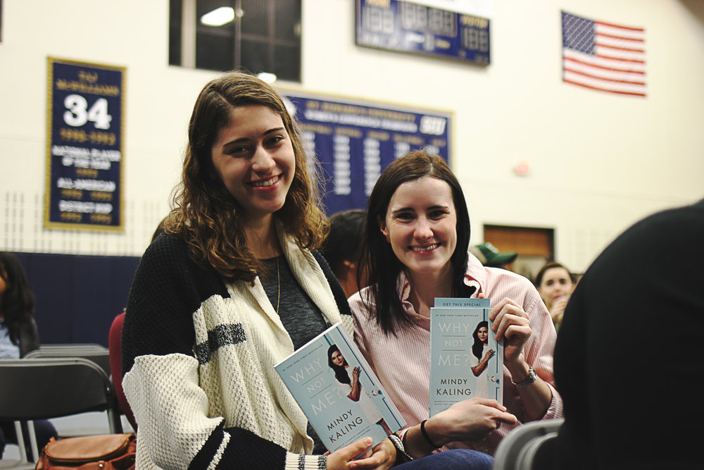 Alyssa Boutelle and Emily Eby show off their books.