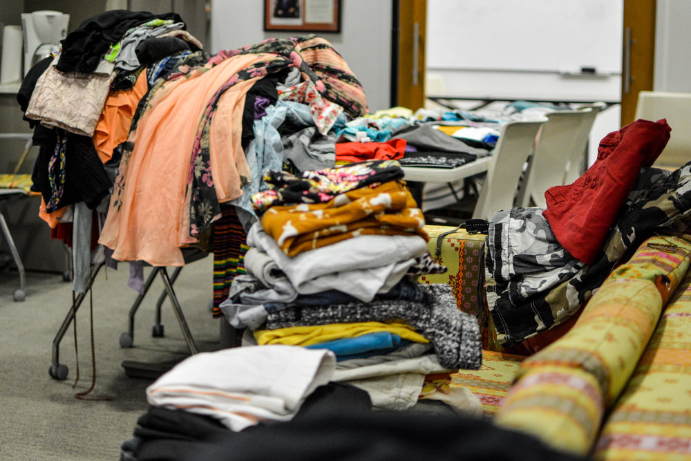 Piles of leftover clothes from the swap are donated to those in need.