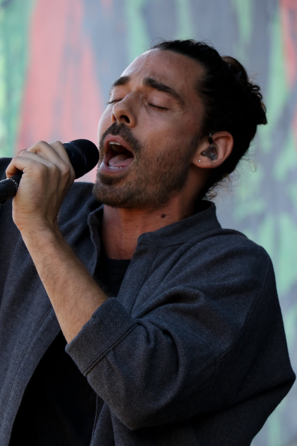 Taylor Rice, frontman of Local Natives, sings for Day 3 festival-goers.