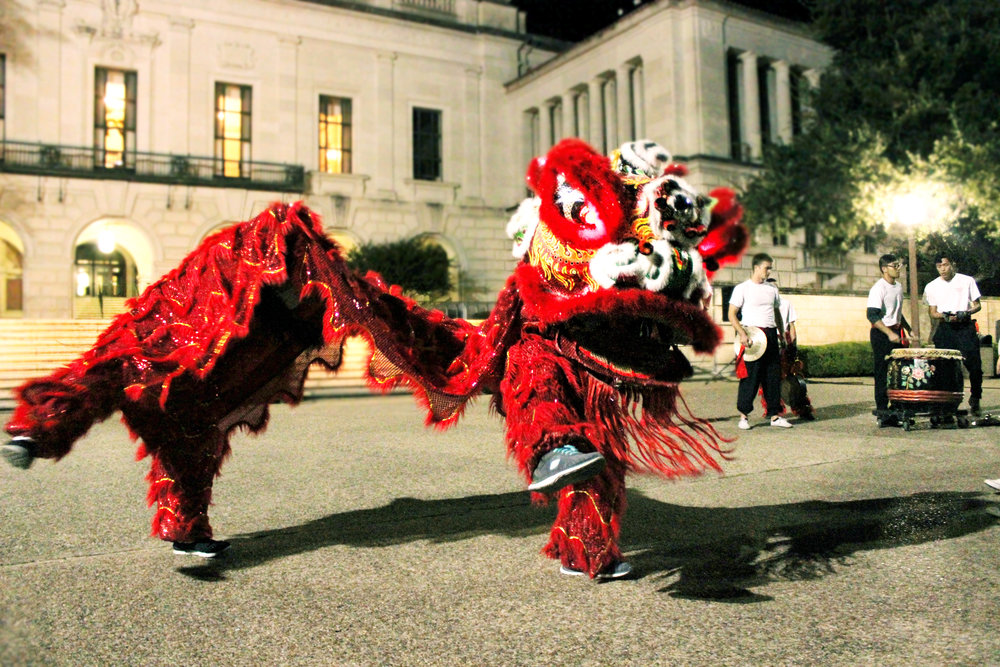The Texas Dragon Dance Team performs in front of the tower.