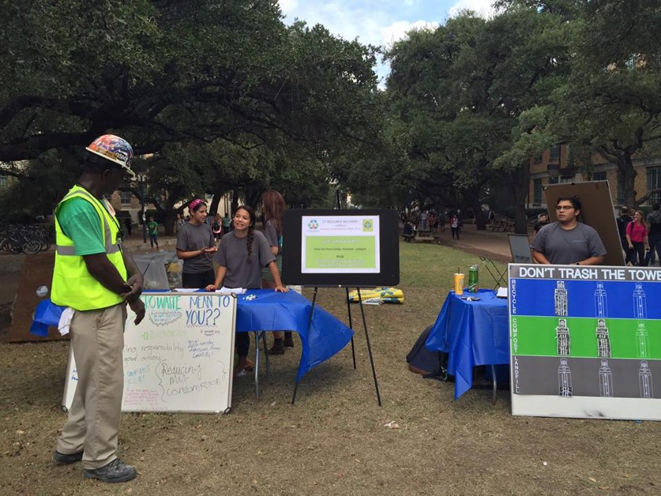 Volunteers help explain what the Zero Waste initiative is all about.