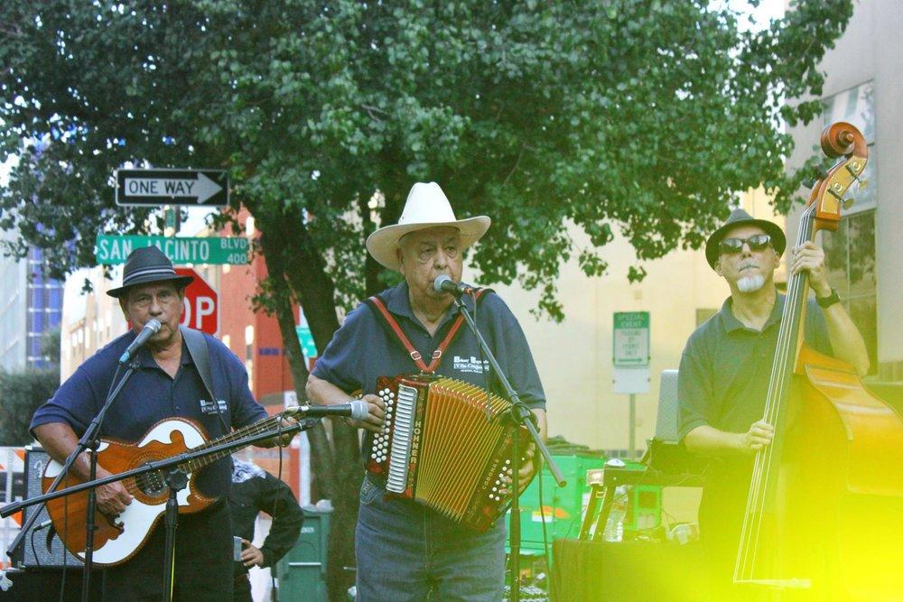 Johnny Degollado y Su Conjunto performs on the outside stage at Viva La Vida.