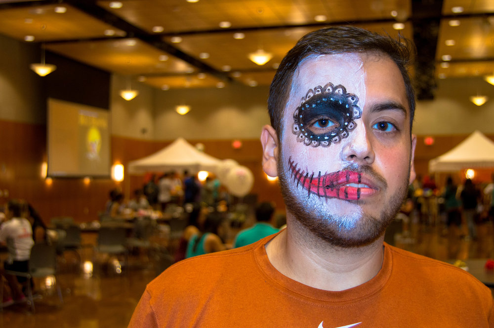 Attendee Toby embraces the half-painted face which stands for the quick transition between life and death.