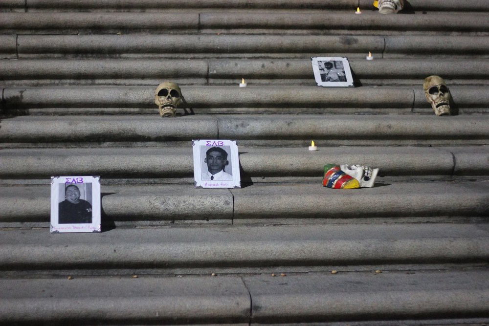 Pictures of deceased loved ones were placed on the steps of the UT Tower by individuals from the crowd to show respect.