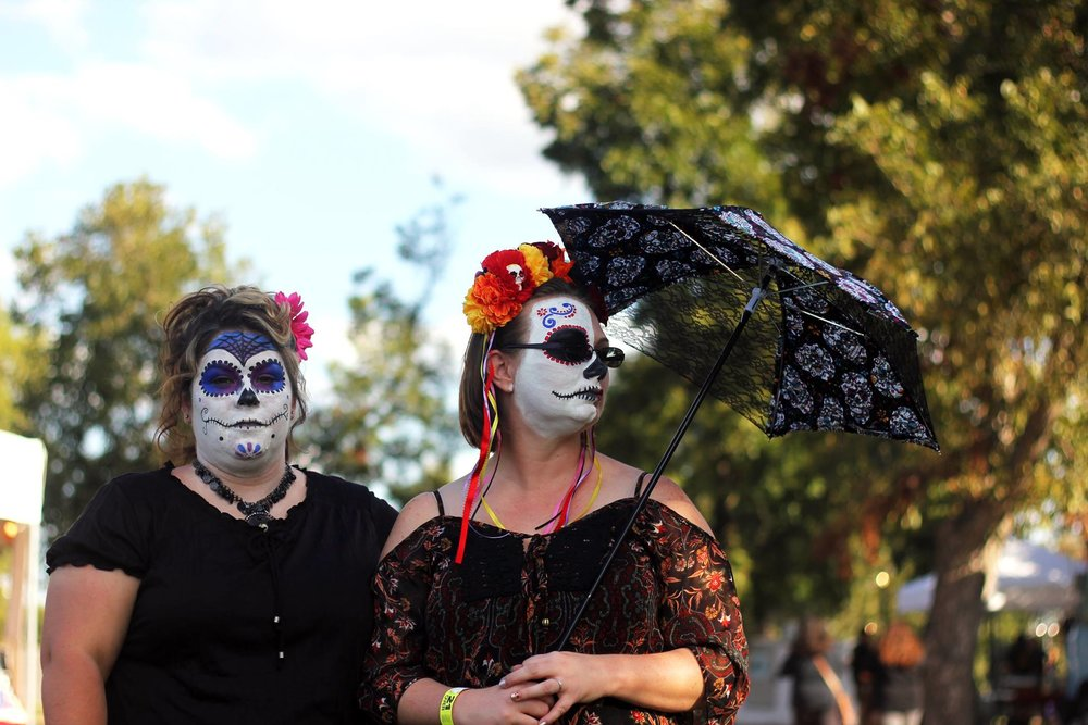 A face painting booth was designated for children and adults to embrace the culture and symbols of the holiday. Two women wear traditional face paint resembling the calavera during the Day of the Dead Music Festival.
