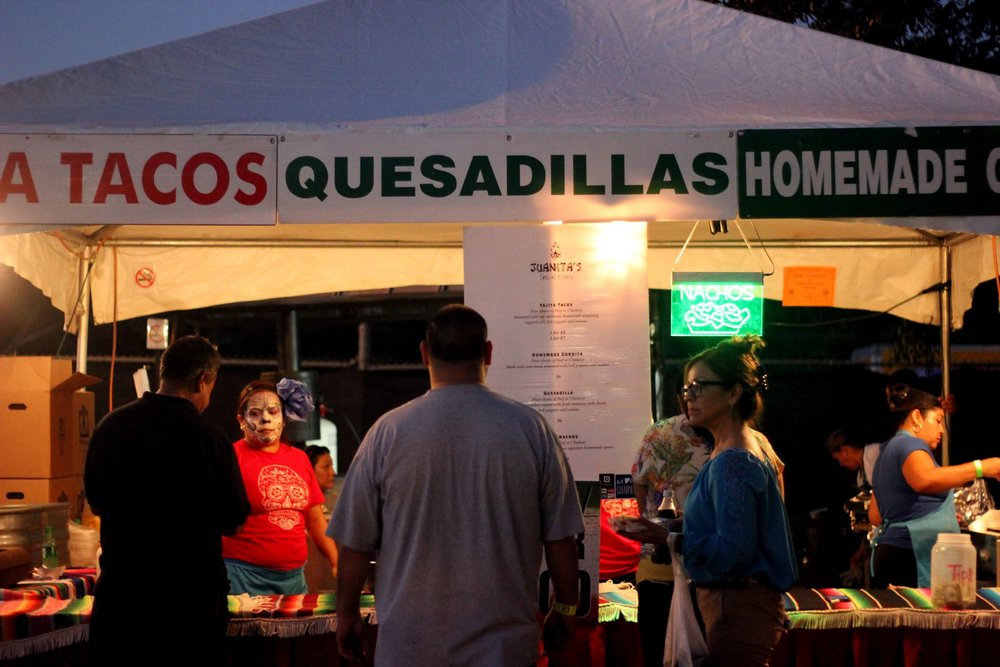 A variety of vendors came to the festival, but left behind foods infused with an array of cultures. Leaving only the familiar to attendees. Including the traditional augas frescas, quesadillas, and tacos de bistek to name a few. People stand in line to have their orders taken.