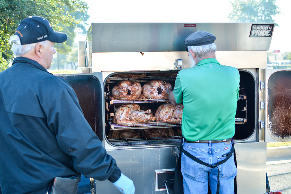 Some of the grill-masters have been volunteering with this operation since it started over 10 years ago, offering their time and equipment, which is needed to roast all 600 turkeys at the Turkey Tailgate in Austin, Texas.