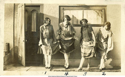 Four women photographed outside of a home. Photo courtesy of Squarespace.