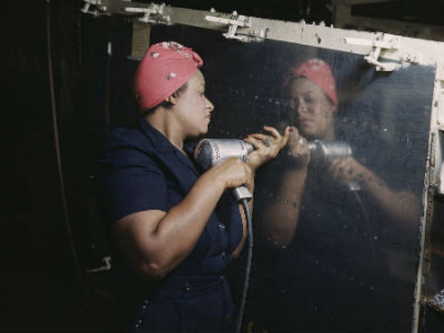 A real-life Rosie the Riveter operating a hand drill in Tennessee. Photo courtesy of the Library of Congress.