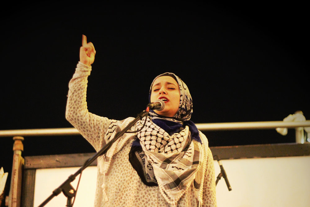 UT Spitshine Member Noor Wadi, performs her spoken word to the crowd.