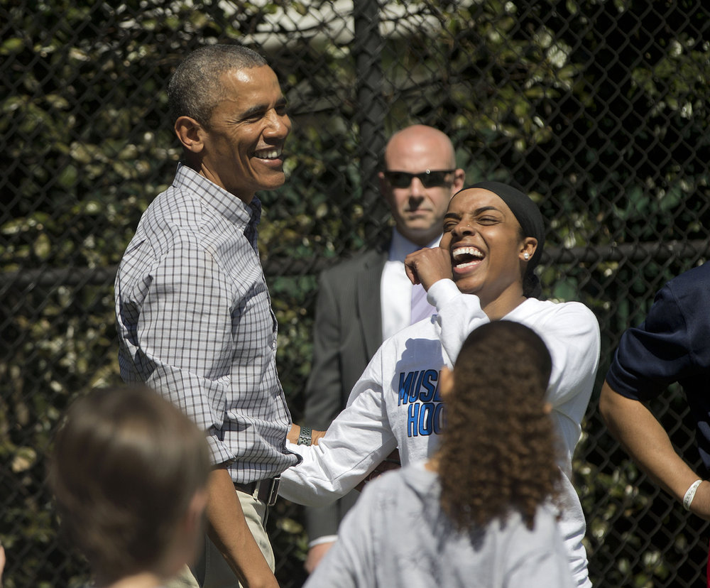 Former President Barack Obama stands with Bilqis Abdul-Qaadir after playing basketball at the White House. Photo courtesy of Pablo Martinez Monsivais/AP.