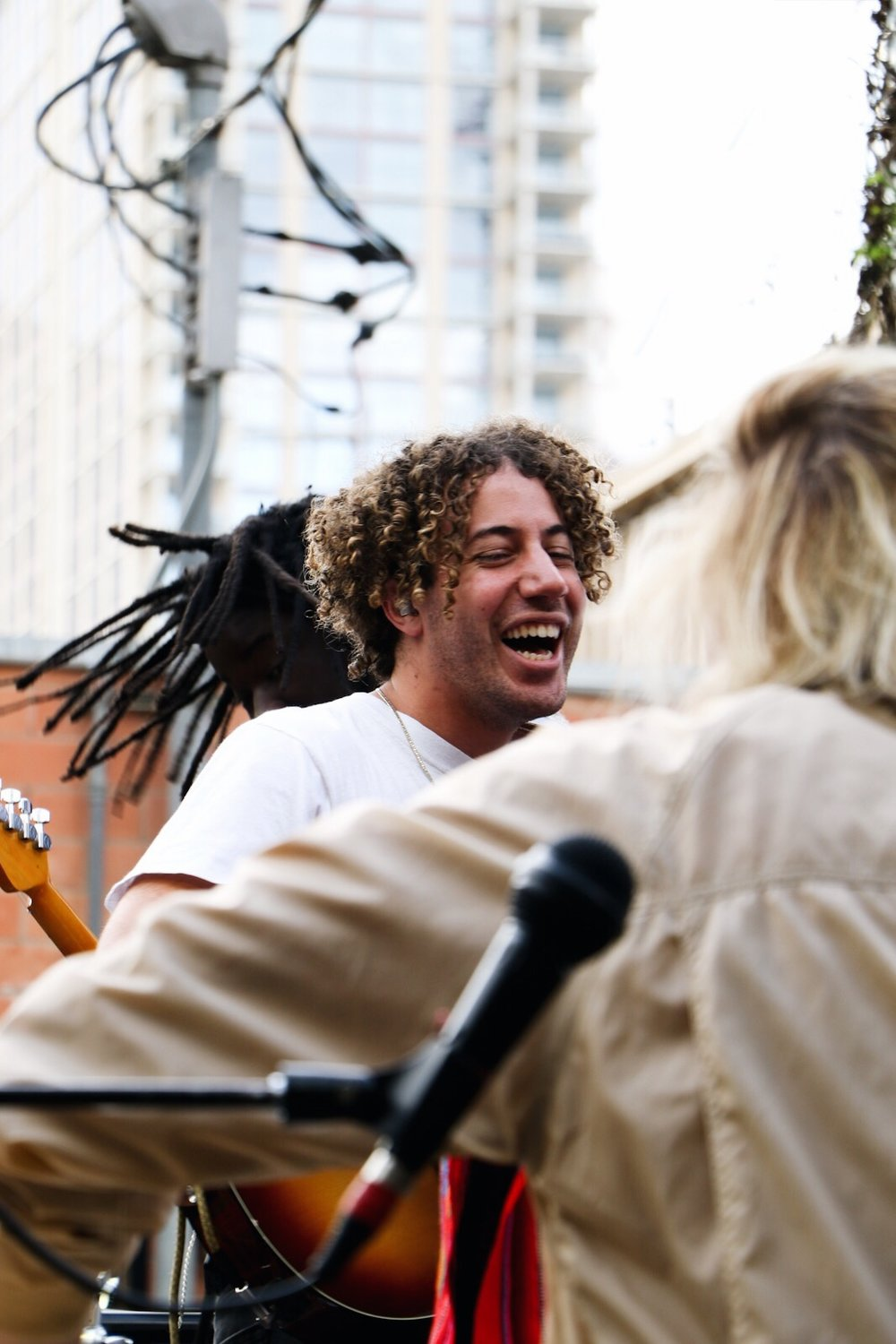 Danny Miller of Lewis Del Mar shares a laugh with the band in between songs.