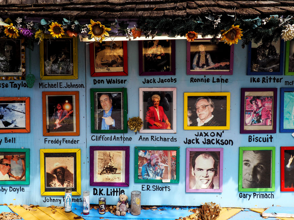 The South Austin Museum of Pop Culture is decorated with posters and pictures of great past artists.