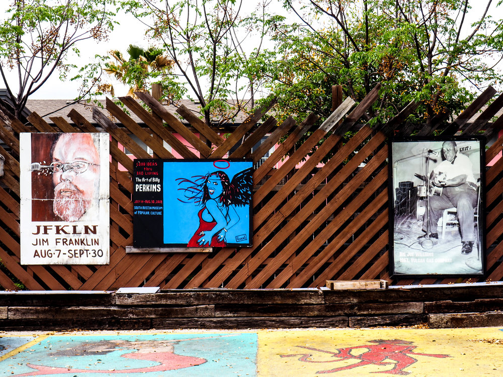 The museum has colorful posters and artistic parking spots.